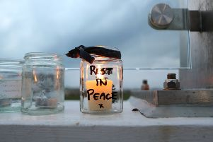 The Bridge of Light in memory of the Shoreham Airshow crash victims. An RIP candle is left. SUS-181224-111720001