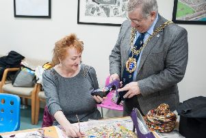 Mayor of Hastings Councillor Nigel Sinden and artist Susan Cleland learn new upcycling skills at Sheryl Hall's shoe workshop SUS-190502-094311001