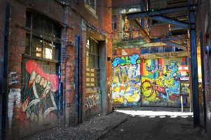 Graffiti pictured down an alley off Claremont in Hastings SUS-190403-093534001