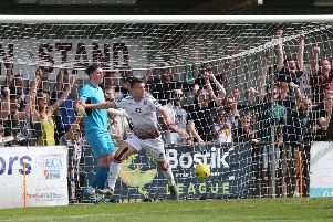 Hastings United supporters enjoy Davide Rodari scoring against Ashford United on Easter Monday. Picture courtesy Scott White