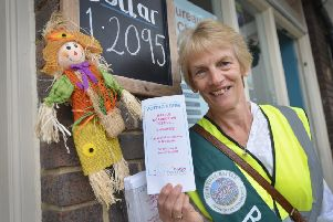 Battle Scarecrow Competition 2019.  Beautiful Battle member Ros Winter holding a scarecrow voting form. SUS-190719-131517001