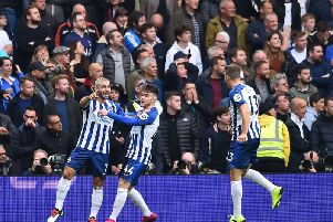 Brighton and Hove Albion striker Neal Maupay celebrates with Aaron Connolly at the Amex Stadium during their 3-0 win against Tottenham Hotspur
