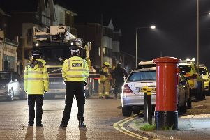 Officers, including armed police, cordoned off London Road in Bexhill SUS-200119-095025001