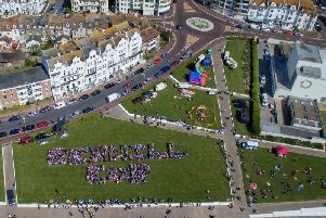 An aerial image of people forming the words Bexhill ER to celebrate Prince Harry and Meghan Markle's wedding in May 2018. Photo by Sussex Air Imaging