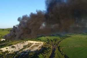 Plumes of black smoke spread over the Sussex coastline. Photo by Eddie Mitchell.