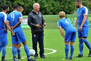Shoreham boss Sammy Donnelly (centre). Picture by Stephen Goodger