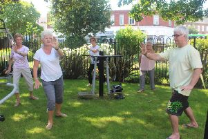 Tai chi in the garden at the Guild Care Centre in Worthing