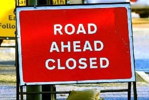 The road may remain closed into this afternoon