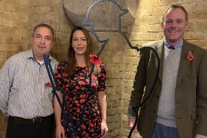 Nick Herbert with his constituency assistant Michelle Taylor and Michael Tu, former Mayor of Arundel and trustee of the There But Not There campaign, alongside one of the Tommy silhouettes in Arundel Town Hall