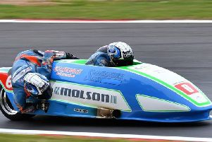 Charlie Richardson (back) leans into the corner with driver Todd Ellis at Brands Hatch