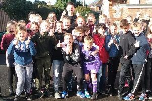Upper Beeding Primary School teacher Elliot Moule, who grew his moustache for the Movember charity last month, with children from his year five and six Morocco class who wore fake moustaches in support SUS-180412-161921001