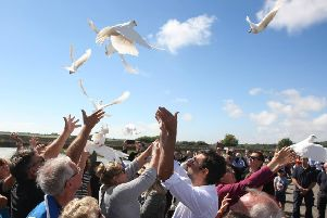 11 doves were released into the air as hundreds gathered to mark the first anniversary of the tragedy