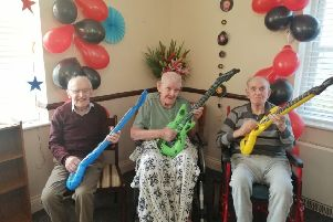 Cavell House residents rocking out at the latest decades event