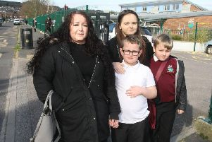 Sarah Wheels and her children, Shannon, 18, Sonny, 7, and Maison, 9