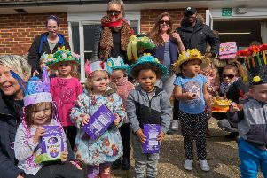 The three winners of the Easter bonnet competition with their Easter egg prizes and others taking part