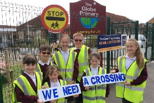 Pupils at the Globe Primary School call for a new pedestrian crossing