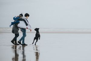 The Butcher's dog food advert features Julie and Harrison Viinikka, alongside their Kerry blue terrier Nessie, on Worthing beach