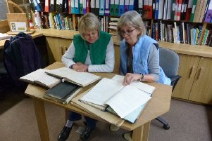 Jane Raistrick, left, and Jane Scott poring over the school log books