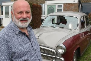 Joe Foxwell from Worthing with his vintage car, which was vandalised. Picture: Derek Martin