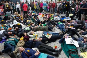 Protestors perform a 'die-in' in Shoreham as part of the Extinction Rebellion protests. Pic: Sean Hawkey SUS-190513-125151001