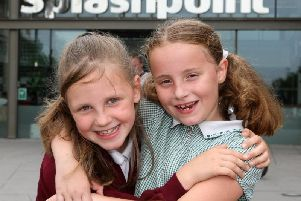 Ruby Davis, eight, and Anna Wallace-Bray, seven, outside Splashpoint Leisure Centre in Brighton Road, Worthing. Picture: Derek Martin Photography