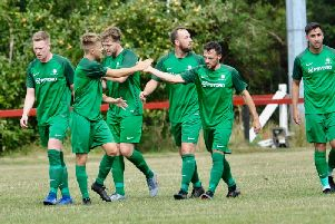 Mile Oak celebrate Adam Dine's stunning strike in the win at Wick. Picture by Stephen Goodger