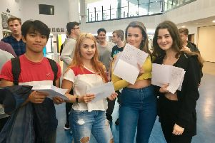 Students at The Littlehampton Academy in Fitzalan Road, Littlehampton, picked up their GCSE results. Natanael Abad, left, and Sacha Tester, right
