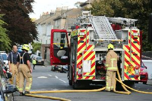 Firefighters work at the scene