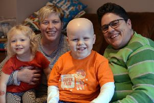 Tate, aged six, with his sister Nell and parents Zoe and Karen Rusbridge Anstey