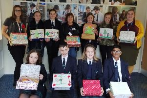 Penny Keen with pupils of The Angmering School as part of the Support Our Soldiers Christmas parcel campaign