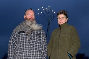 Artists Jane Fordham and David Parfitt stand in front of the lights installation, which forms the last part of the Shoreham Airshow disaster memorial on the River Adur