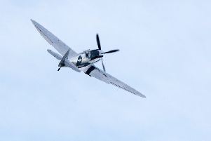 DM19120954a.jpg. A newly-restored spitfire aircraft lands at Goodwood following a 27,000 mile journey around the world. Photo by Derek Martin Photography. SUS-190512-170945008