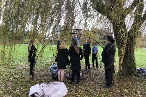 Year-nine students building a shelter as part of their expeditioning lessons