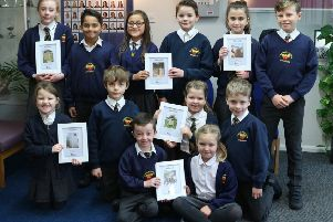 Children from each class at St Margaret's Primary School with their toilet twinning certificates