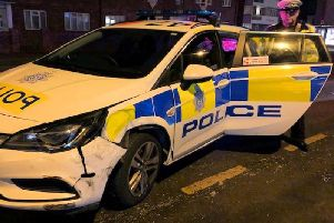 PC James King, of the Roads Policing Unit, with the damaged police car