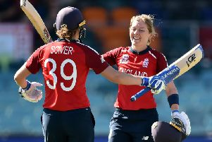 Heather Knight cellebrates her ton with Nat Sciver. Picture by Getty Images
