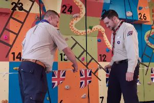 West Sussex Scouts' county climbing adviser James Wright and district commissioner Cameron Baldock officially open the climbing wall