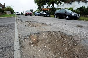 Road surface issues on the unadopted part of a road in Sussex