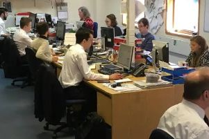 Journalists at work in one of out trusted local newsroom