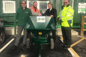 Coun Graham Fisher (second right) is presented with the new gritter by (from left) Mark Kay. Murphy project director, Scott Marsden, Murphy project manager and Martin Knagg, Triton Knoll package manager. ANL-190117-154231001