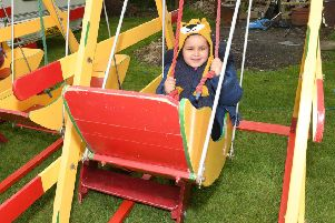 Family Fun Day at Village Church Farm, Skegness. Ellie-Mae Ryan 5 of Skegness on a swing boat.