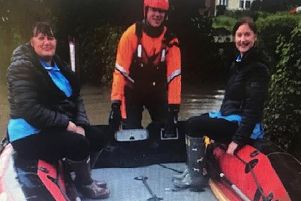 Lincolnshire Fire and Rescue helped Tracey Fiddler and Lisa Chapman of Bluebird Care reach their customer at Great Steeping in a dinghy.