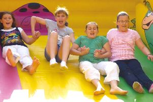 Pictured (from left) were Frankie Machin, 10, Chloe Lidster, 10, Aimee Emerson, 11 and Jazmin Moore, 10, of Friskney, having a great time on an inflatable slide.