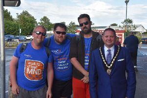 Ross Keeling with friends Liam and David Percival are greeted on their arrival in Skegness by the Mayor of Skegness Coun Mark Dannatt. Photo: Barry Robinson.