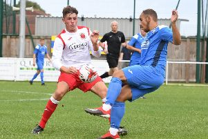 George Hobbins battles for the ball.