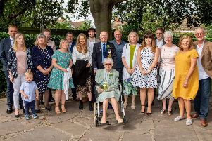 Mr and Mrs Wells pictured (centre) with family after renewing their vows to mark their 60th wedding anniversary. Photos by John Aron.