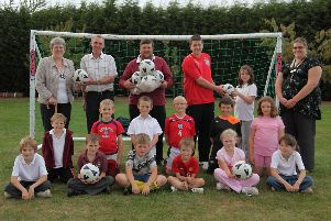 Partney CofE Aided Primary School's football team in 2009, with some of its sponsors, (from left) Sandra and Philip Boulton, of Spilsby Lions, and Robin Dennett, of Dennetts Ice Cream, plus coach Tom Kelly and teacher Becky Bailey.