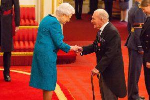 George  'Johnny' Johnson is made an MBE (Member of the Order of the British Empire) by Queen Elizabeth II at Buckingham Palace. (Photo credit: Dominic Lipinski/PA Wire).