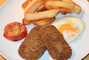 Spicy spam fritters with chips and egg.