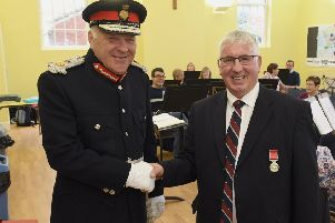 Former Director of Music of Sleaford Concert Band, Jim McQuade receiving BEM from Lord Lieutenant, Toby Dennis. EMN-180810-102940001